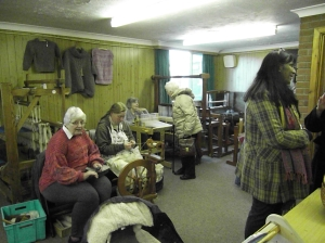 Kath Appleton demonstrating her weaving and Marion Starks demonstrating her supe- fast hand spinning skills.