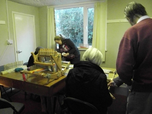 Stan and Ellie showing our visitors how to use the different types of looms.