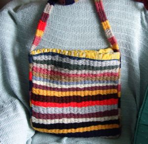 Multicoloured shoulder bag - Hand woven on a peg loom. The handle was made using weaving sticks. Lesley Bone