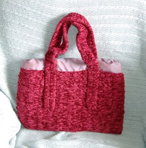 Chenille Handbag - Woven on a peg using chenille wool. The handle was made using weaving sticks. Lesley Bone